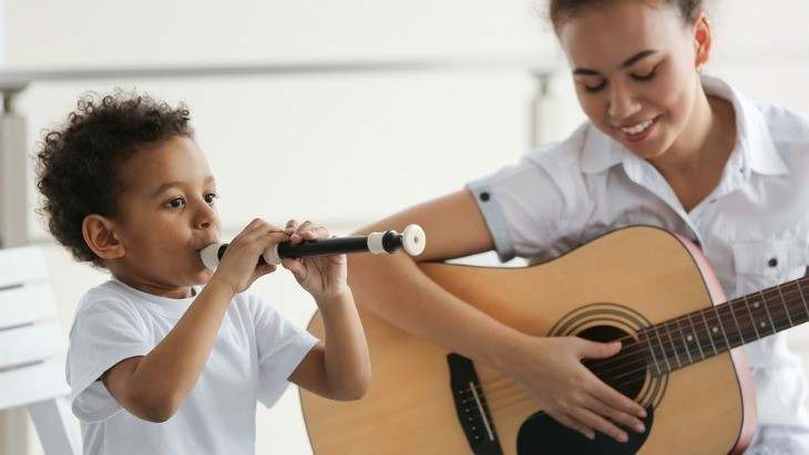 Little boy with Recorder and teacher playing