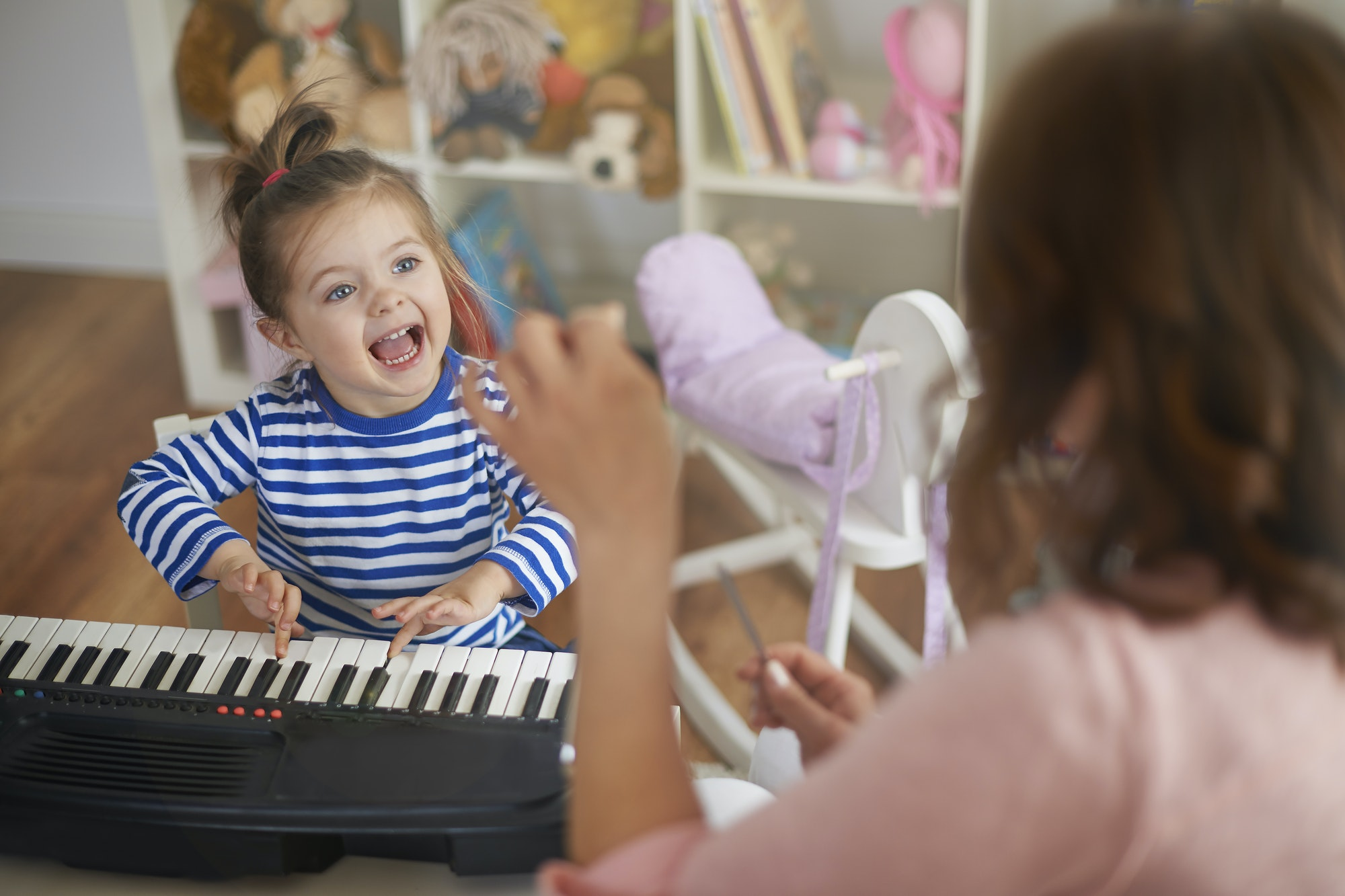 Girl Singing and playing on musical instrument